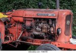 a-vintage-red-bmc-nuffield-42-tractor-parked-in-a-lane-in-the-new-f0mh7m.jpg